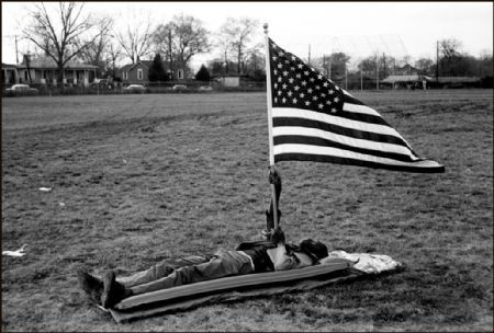 photo boy-on-ground-with-flag-selma.jpg THE WEST IS THE BEST - photographies